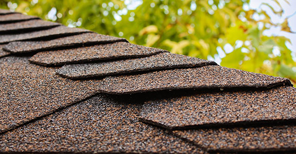 New-asphalt-shingles-on-a-residential-home-roof