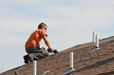 Roofing contractor working on a roof repair