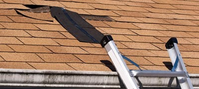 Storm damaged roof inspected by a roofing contractor for repiars